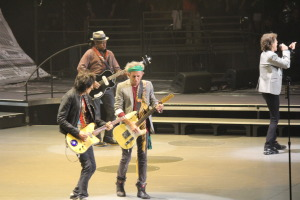 Rolling Stones guitarist Keith Richards (center) and Ronnie Wood (left) playing guitar, Mick Jagger singing